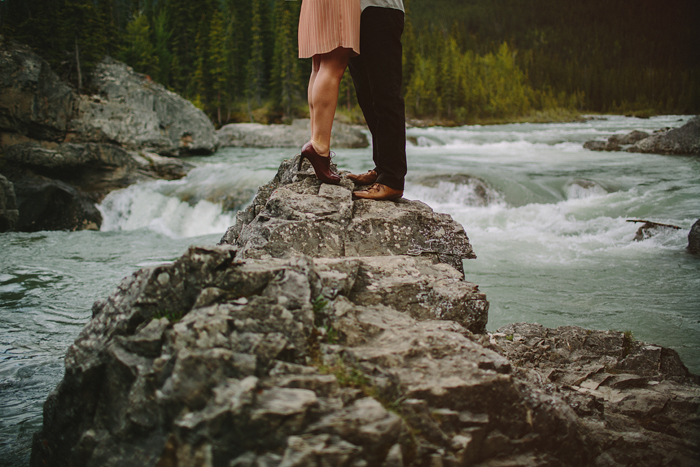 calgary wedding photographer, engagement, embrace, mountains, storm, rain, wind, chasing light, connection, elbow falls, bragg creek, ©Gabe McClintock | www.gabemcclintock.com