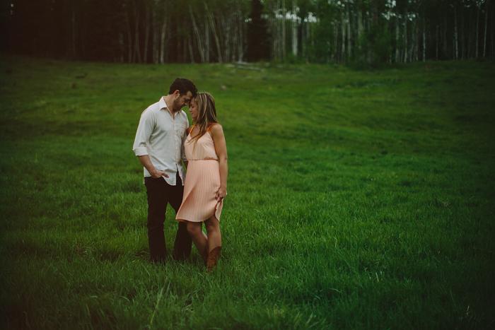 calgary wedding photographer, engagement, embrace, mountains, storm, rain, wind, chasing light, connection, elbow falls, bragg creek, ©Gabe McClintock | www.gabemcclintock.com